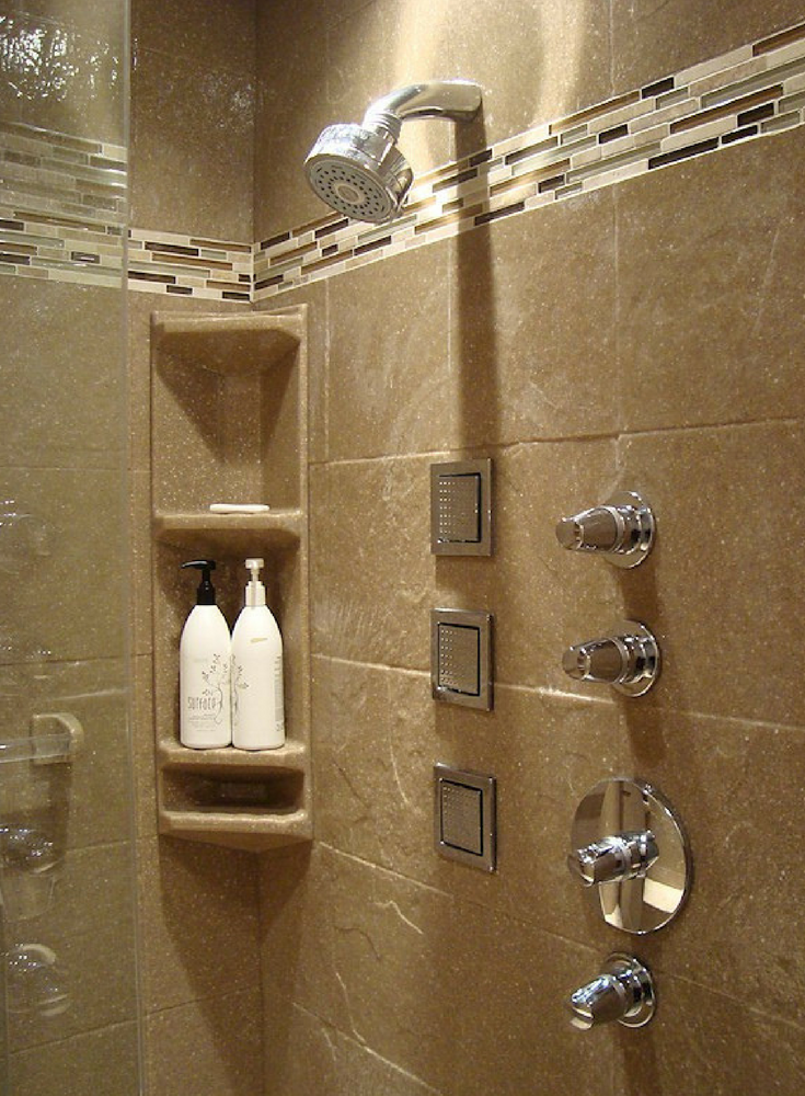 3D textured faux stone solid surface shower wall panels with a decorative border | Innovate Building Solutions