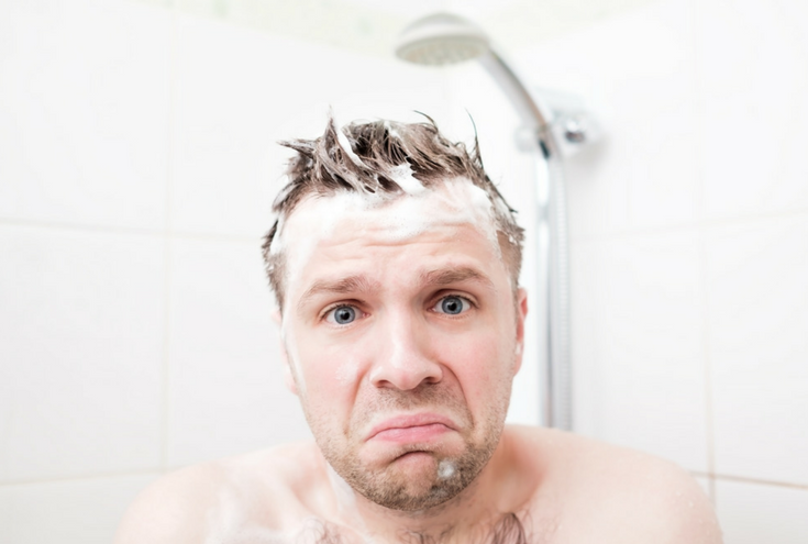 A man not enjoying a cold shower is a reason to remodel a bathroom | 15 Reasons You Shouldn't (and 10 Reasons You Should) Remodel Your Shower | Innovate Building Solutions