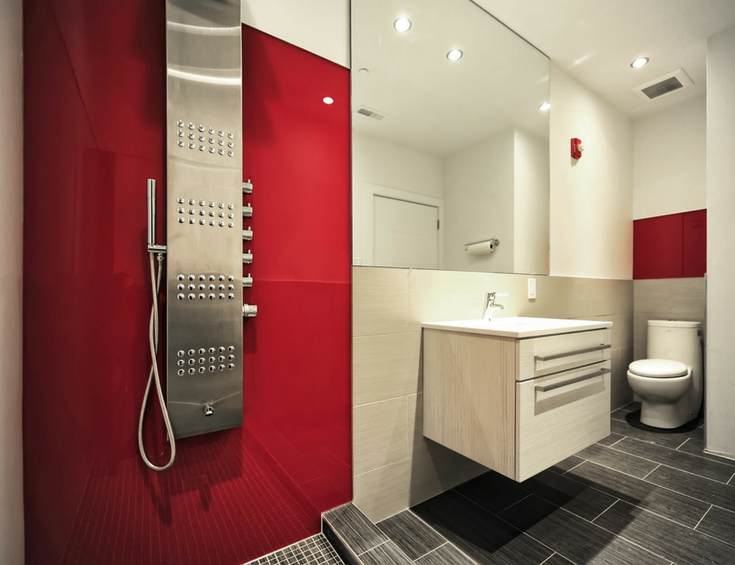 Bright fire engine red high gloss shower wall panels in a contemporary Euro-inspired bathroom | Innovate Building Solutions #HighGloss #Shower #WallPanels #Remodeling
