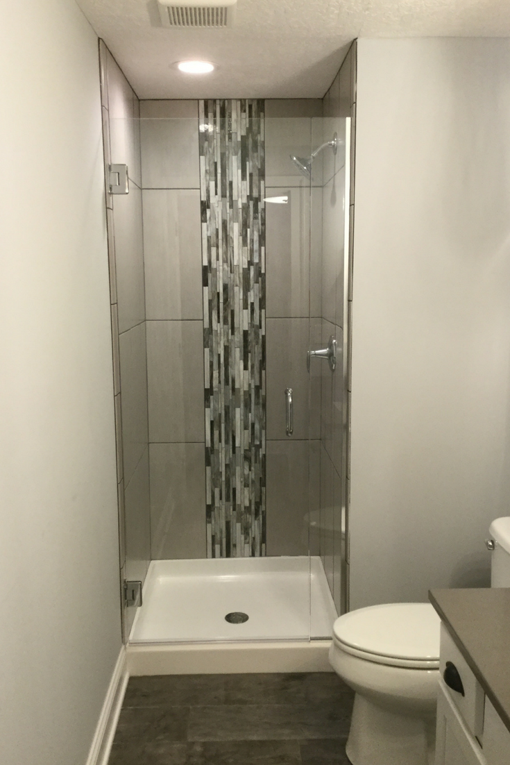 Vertical Shower Tile Wall | Innovate Building Solutions #ShowerSystem #VerticalTile #ShowerSurround