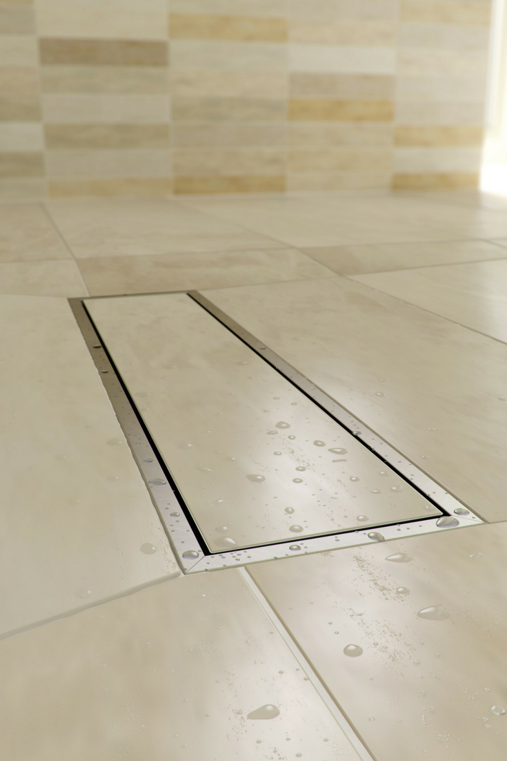 Linear shower drain with large tiles in a contemporary one level tile shower wet room | Innovate Building Solutions #WetRoom #LinearDrain #ShowerDrain