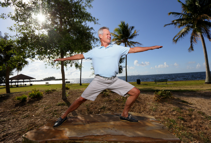 Man enjoying doing yoga on the beach | 15 Reasons You Shouldn't and 10 Reasons You Should Remodel Your Bathroom in 2018 | Innovate Building Solutions