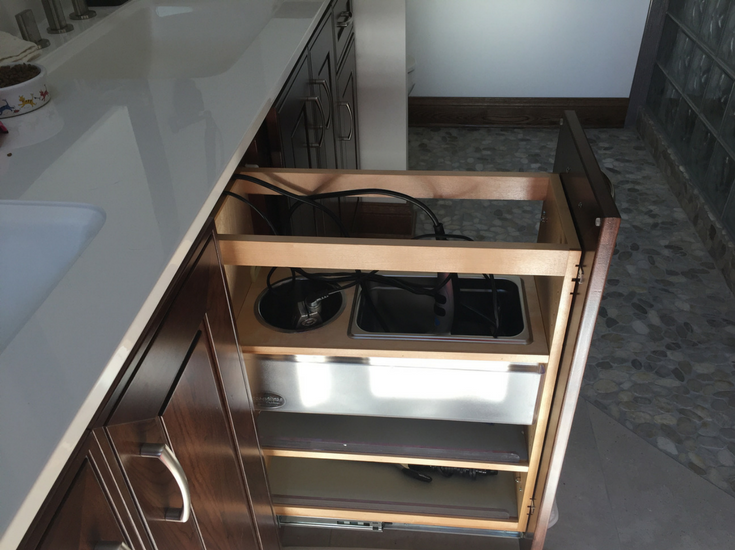 Slide out bathroom vanity shelves make it easy to find your blow drier and curling iron | Innovate Building Solutions #Vanity #BathVanity #Accessible #Remodeling