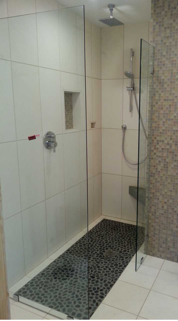 Roll in one level wet room system in a tiny bathroom, - Innovate Building Solutions #WetRoom #Shower #BarrierFreeShower