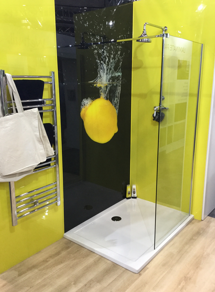 Black and lemon colored high gloss wall panels with a high resolution digital lemon image | Innovate Building Solutions #ShowerPanels #HighGloss #Contemporary #ModernWalls