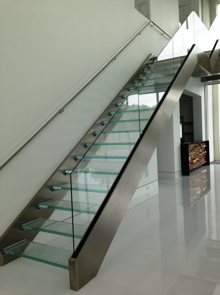 A floating glass staircase in a modern home | Innovate Building Solutions