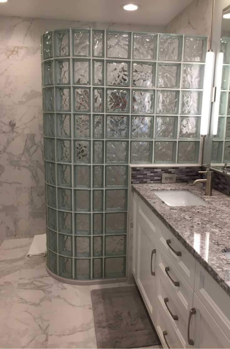 A California bathroom remodeling project with a glass block walk in shower and a solid surface shower base | Innovate Building Solutions