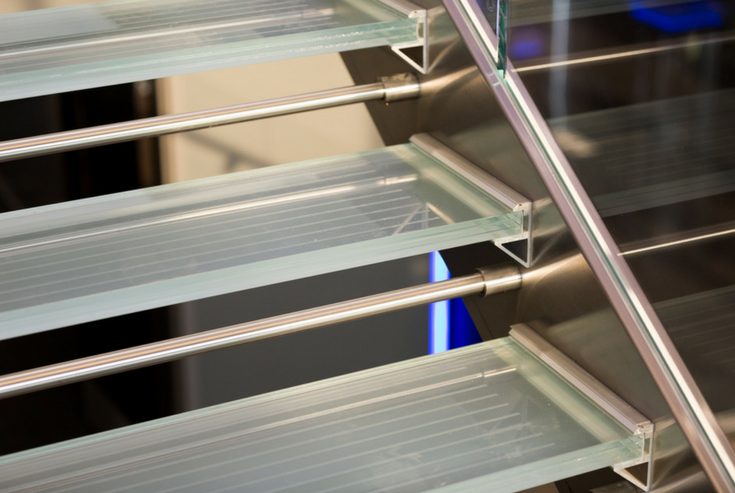 Close up of a glass stair tread bracket aluminum support system | Innovate Building Solutions