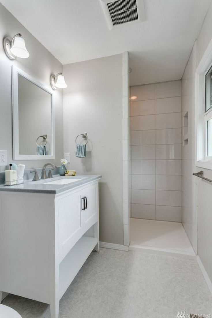 Low barrier shower pan offset design with transitional shaker style cabinets | Innovate Building Solutions