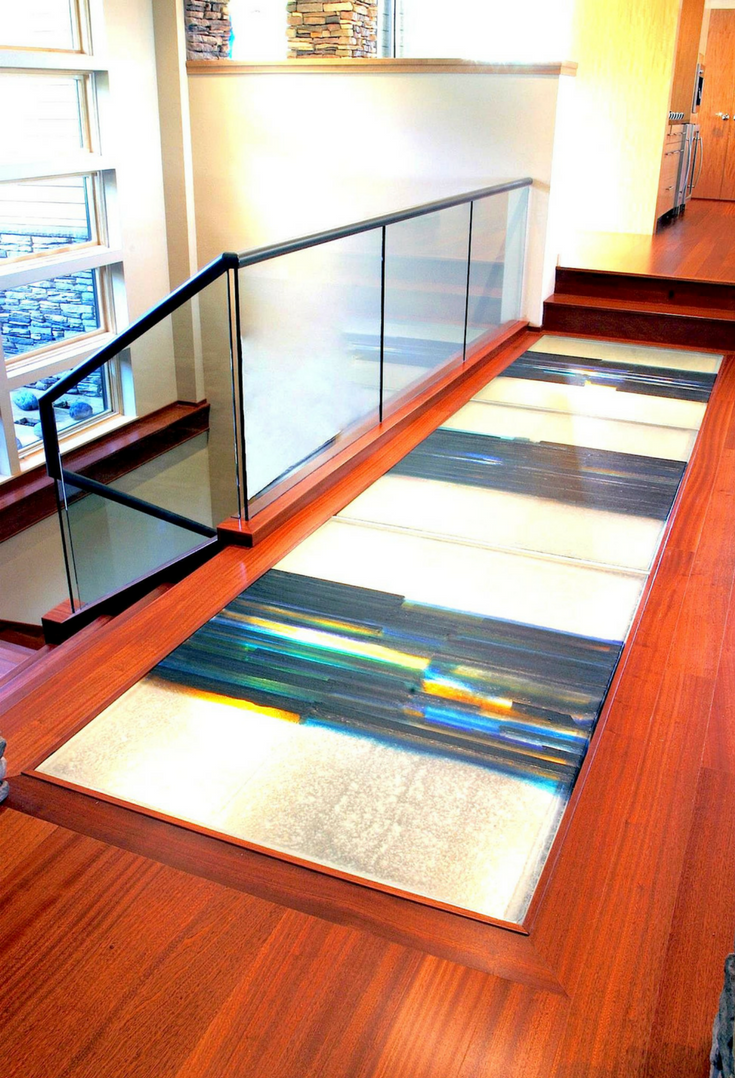 Multi-colored cast glass art bridge in a contemporary home | Innovate Building Solutions