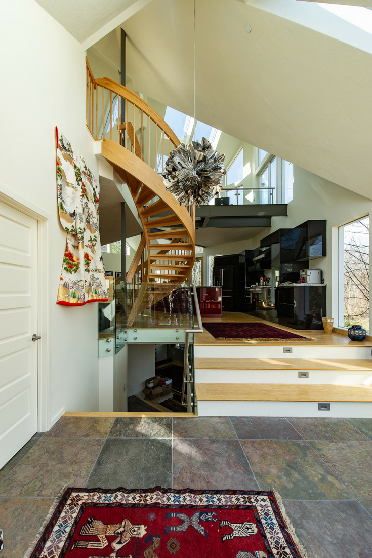 Focal Point as you Walk In Luxury Condo | Innovate Building Solutions | #FocalPoint #LuxuryHomes #Staircase