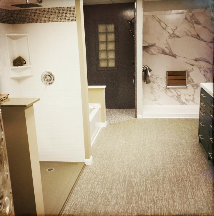 Shower Wall Panels in Showroom | Innovate Building Solutions | #ShowroomBathroom #BathroomRemodel #DIYShowerPanels