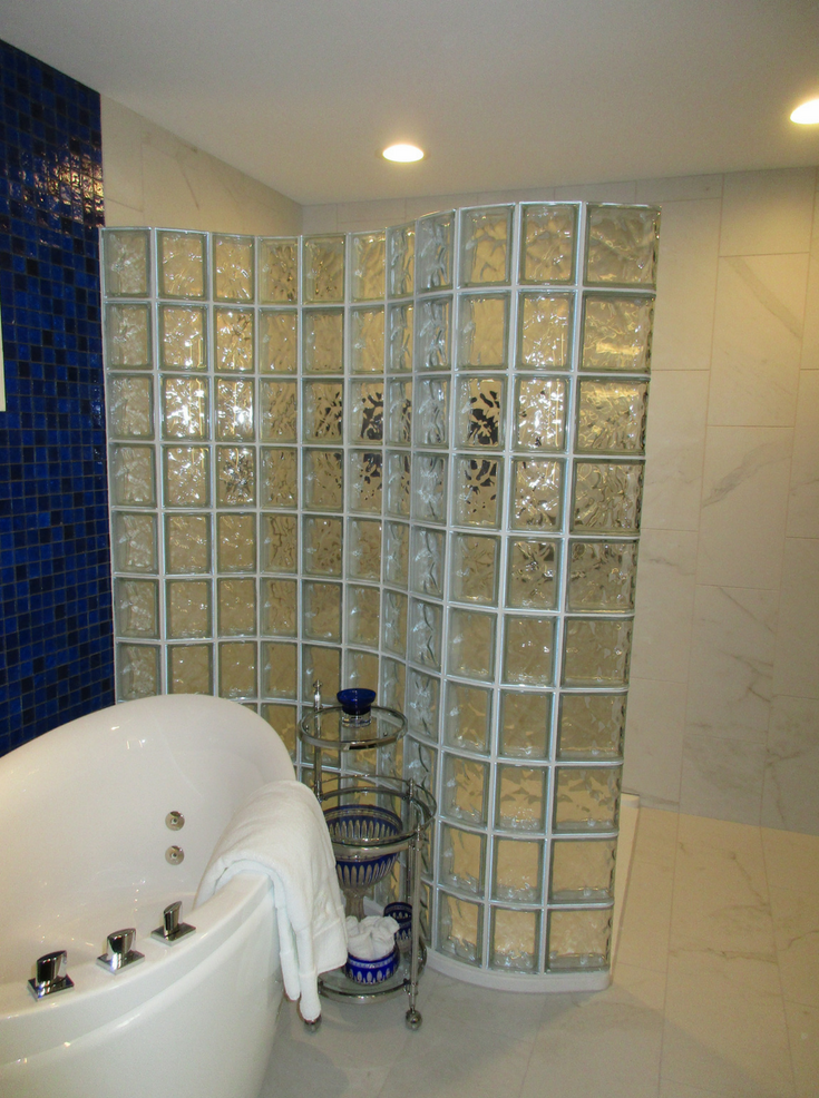Glass Block Wall That Snakes Around Tub | Innovate Building Solutions | #GlassBlockWall #GlassBlockDesign #CondoLiving