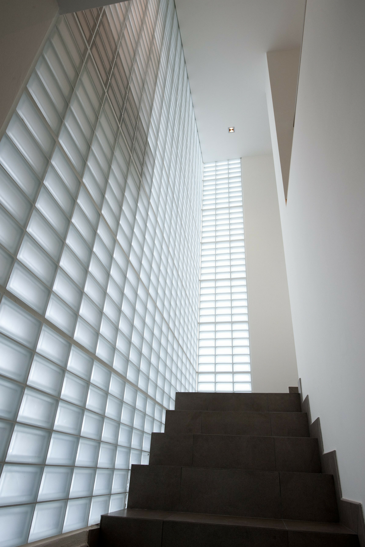 Frosted glass block stairwell in a modern home- Innovate Building Solutions
