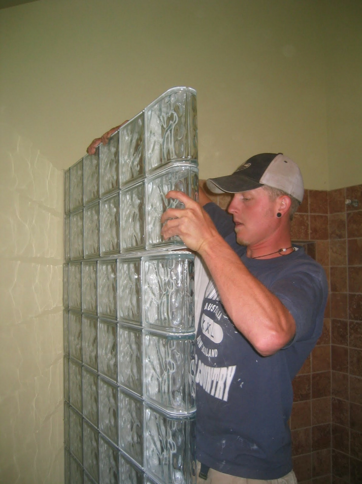 Installing Glass Block Wall That was built in sections | Innovate Building Solutions | #GlassBlockInstall #GlassBlockWall #ShowerWall