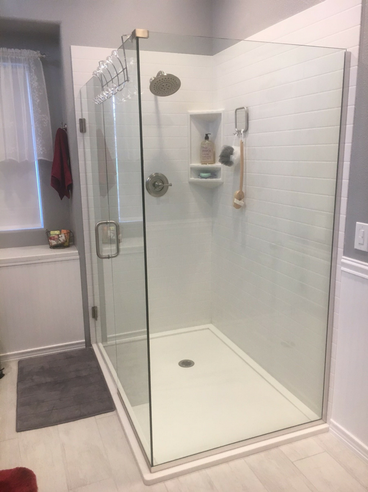 Solid Surface Shower in subway tile pattern | Innovate Building Solutions | #SubwayTile #ShowerPanels #ShowerBase