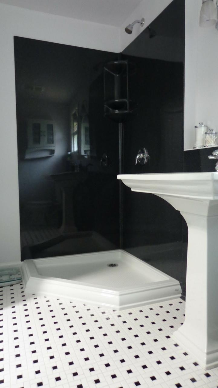 Solid Surface in a Corner Shower | Innovate Building Solutions |  Innovate Building Solutions | #SolidSurfaceProducts #ClevelandRemodel #ShowerPanel #ShowerBase