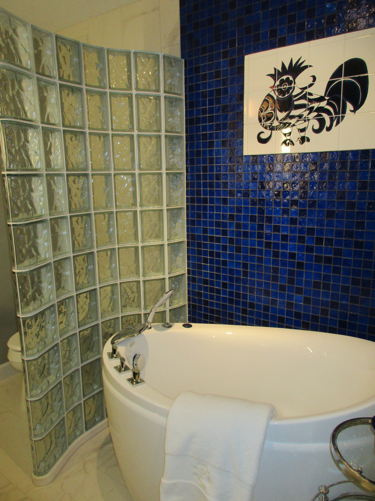 The Bird in the Tile Wall - Glass Block Wall | Innovate Building Solutions | #GlassBlockWall #TileWall #ShowerRemodel
