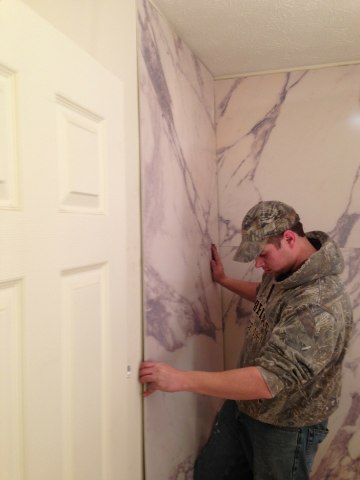 Bathroom wall panel installation | Innovate Building Solutions | #WallPanels #BathroomInstallation #ShowerPanels
