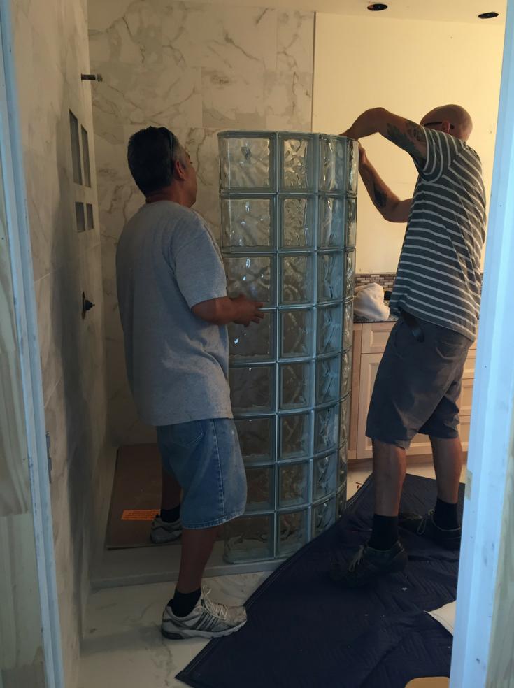 Curved glass block sections being installed   Innovate Building Solutions   #InstallingGlassBlock #GlassBlockShower #GlassBlock