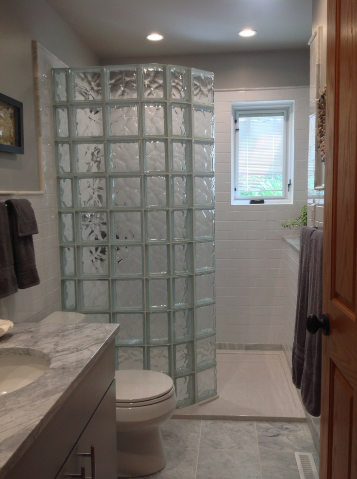 Glass block curved shower wall | Innovate Building Solutions | #GlassBlock #GlassBlockDesign #WalkInShower