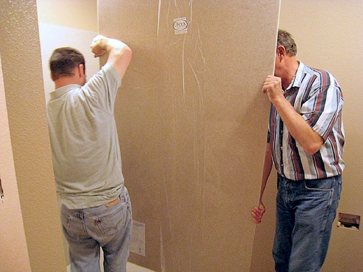 Installing solid surface shower panels | Innovate Building Solutions | #SolidSurface #ShowerRemodel #ClevelandRemodel