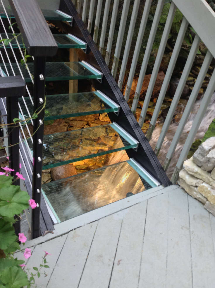 Water running under glass treads A McClure | Innovate Building Solutions | #GlassStairs #StructuralGlass #BeautifulGlass