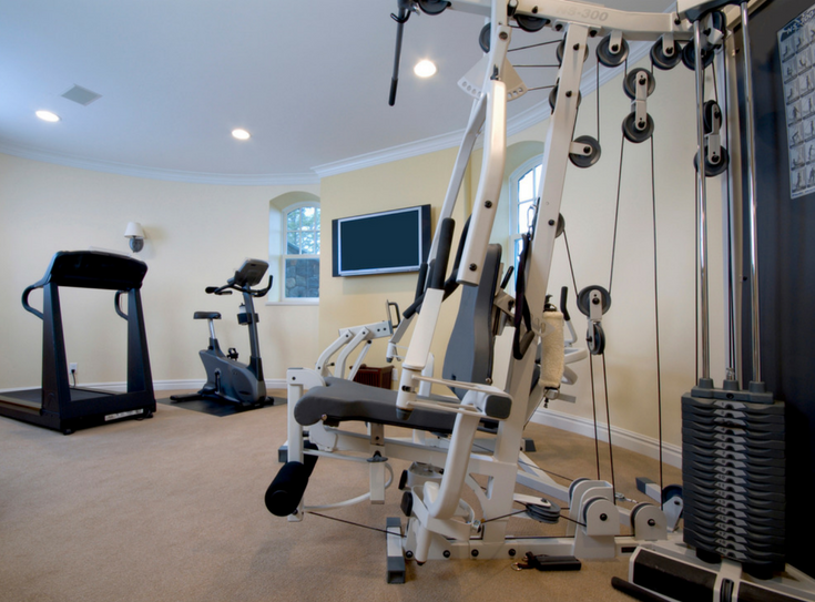 Create private spaces in basement exercise room | Innovate Building Solutions | #BasementExerciseRoom #BasementRemodel #GlassBlockWindows
