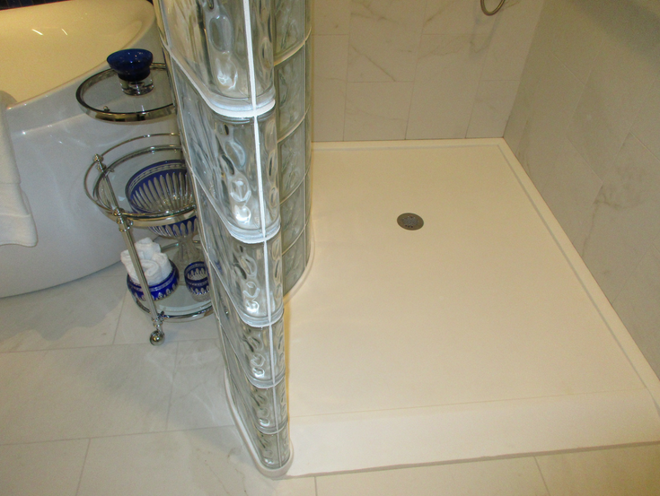 Curved glass block shower base | Innovate Building Solutions | #GlassBlockBase #ShowerBase #GlassBlockShowerWall