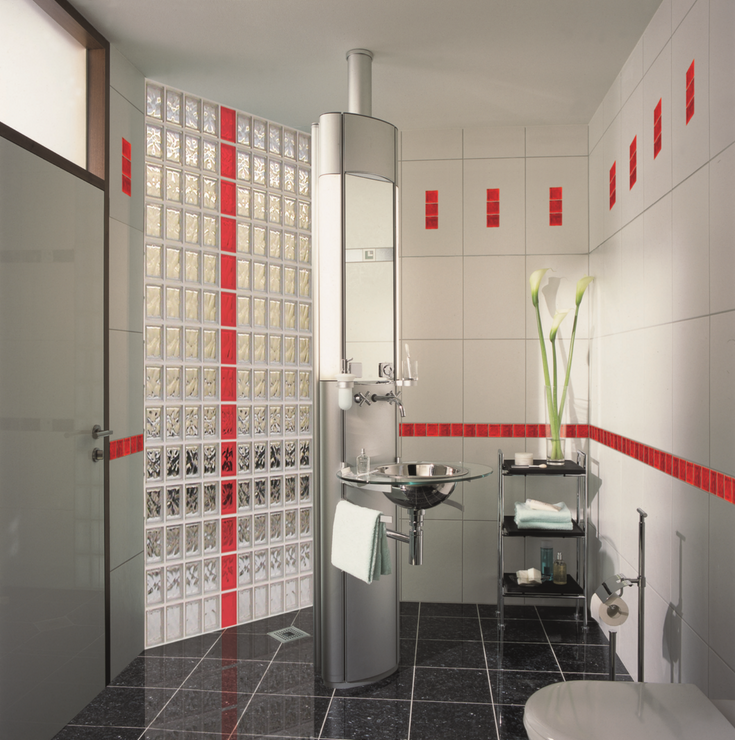 Glass block shower wall with a red vertical stripe | Innovate Building Solutions | #ColoredGlassBlock #GlassBlockInstallation #GlassBlockBase