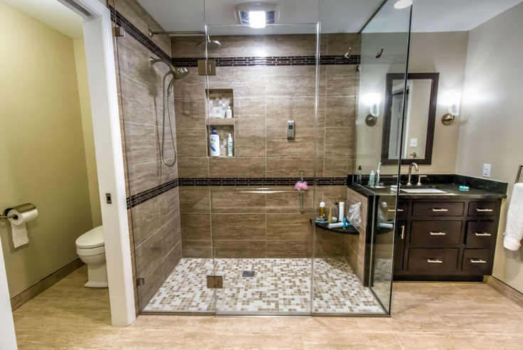 Glass enclosure with a flat floor barrier free shower system | Innovate Building Solutions | #ShowerSystem #BathroomRemodeling #TiledShowerBase
