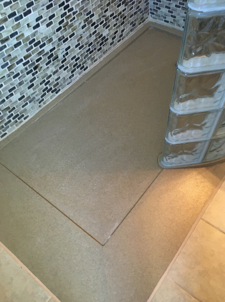 Ramped roll in stone solid surface pan | Innovate Building Solutions | #ShowerBase #StoneBase #ShowerRemodel