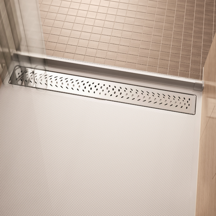 An acrylic zero threshold shower base with a linear drain | Innovate Building Solutions
