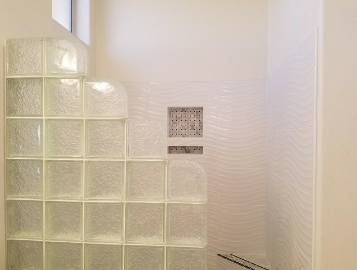 Glass block icescapes pattern wall   Innovate Building Solutions   #GlassBlockWall #GlassBlockDesign #StepDownGlassBlock