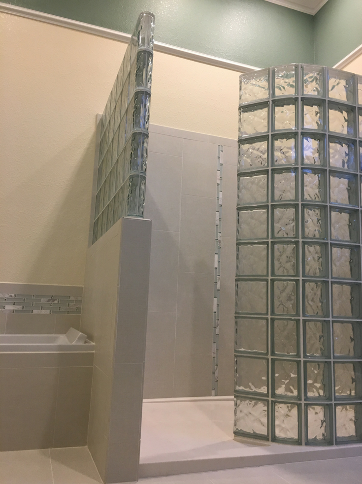 Glass block walk in shower with a curved wall | Innovate Building Solutions | #GlassBlockShower #ShowerWall #WalkInShower