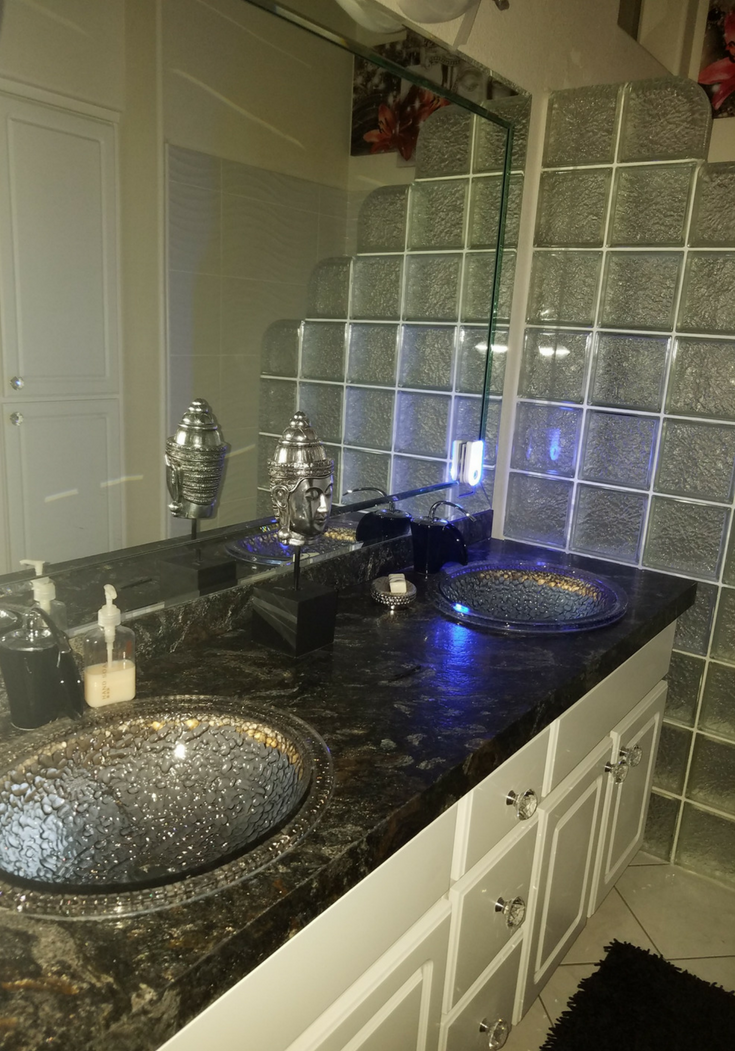 Mettalic leather countertop in a las vegas bathroom | Innovate Building Solutions | #BathroomSink #LeatherCountertop #LasVegasBathroom