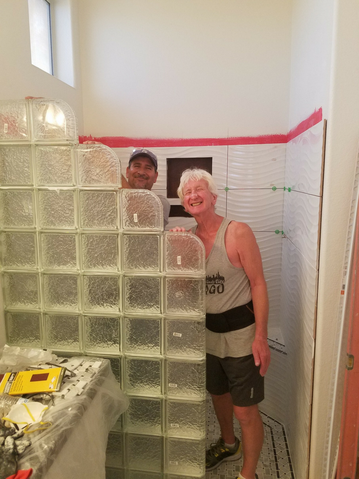 Vic and Mario doing the glass block wall | Innovate Building Solutions | #GlassBlockInstallation #ShowerRemodel #Contractors