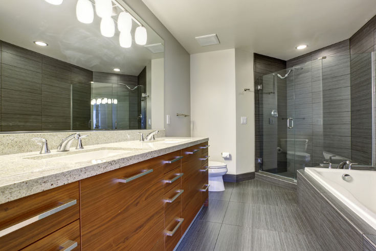 Engineered wood flooring in a bath remodel | Innovate Building Solutions | #BathroomFlooring #EngineeredWood #BathroomRemodel