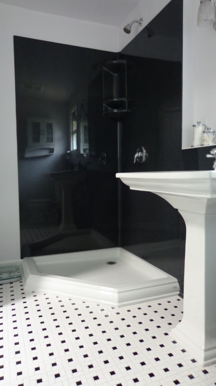Solid surface wall panels in a black color   Innovate Building Solutions   #SolidSurface #ShowerPanels #SolidSurfacePanel