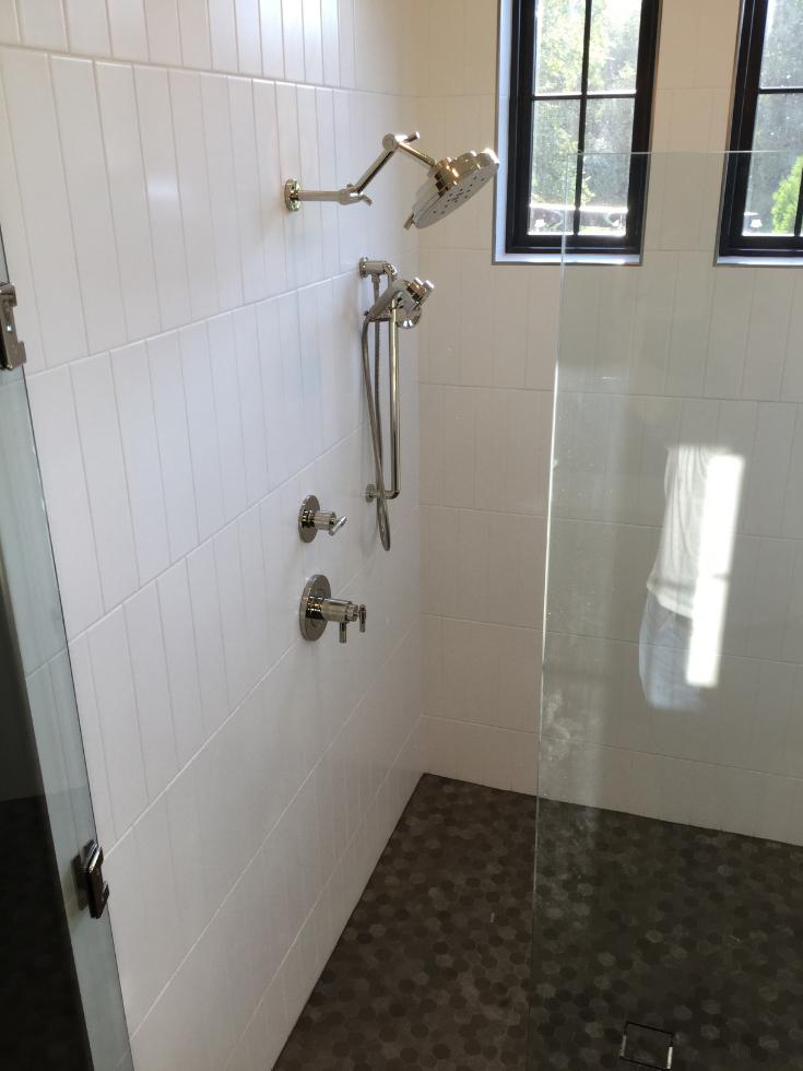 Black trimmed transom windows in a Columbus shower 3 Pillar Homes | Innovate Building Solutions | #BathroomDesign #ShowerWinodw #BathroomTrends