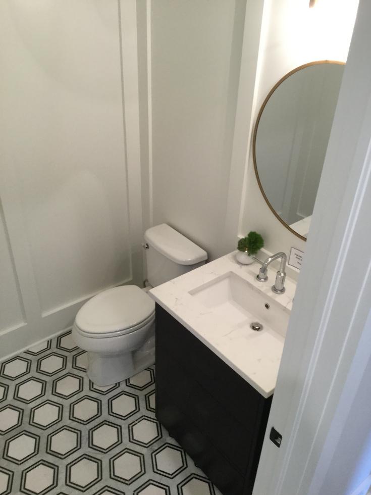 Geometric tile in a powder room Memmer Homes | Innovate Building Solutions | #GeometricTile #BathroomDesign #BathroomTrends
