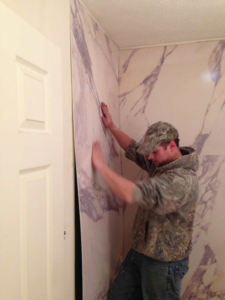 Installing faux granite wall panels | Innovate Building Solutions | #FauxGrante #DIYShowerPanels #InstallingPanels