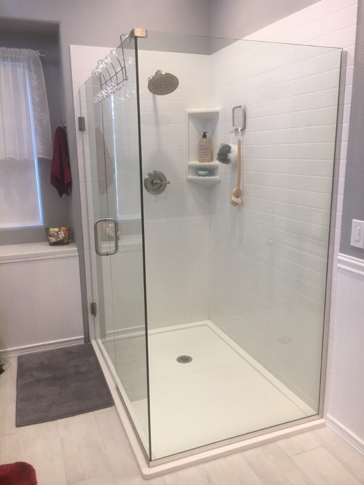 Custom solid surface pan with custom drain location | Innovate Building Solutions | #CustomShower #ShowerBase #SolidSurfaceBase