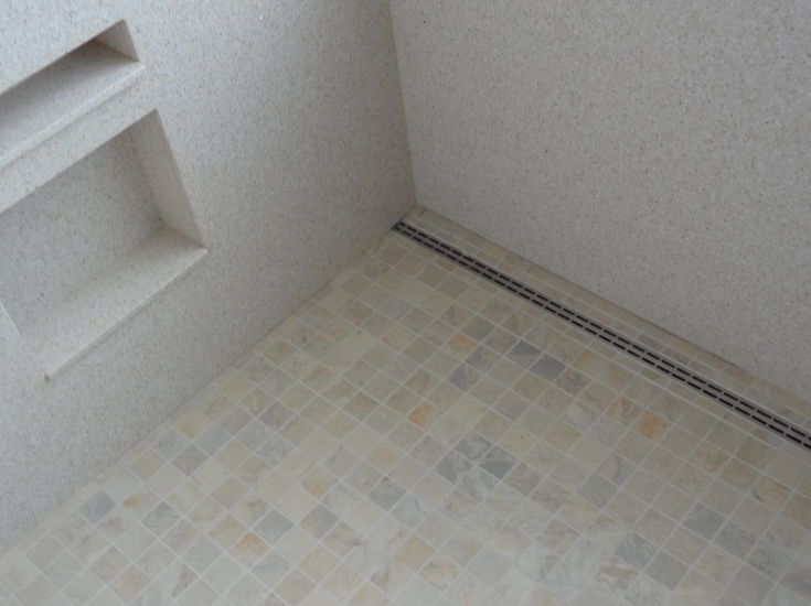 Drain close to the edge of the shower wall | Innovate Building Solutions | #Drain #ShowerDrain #BathroomShower #WalkInShower