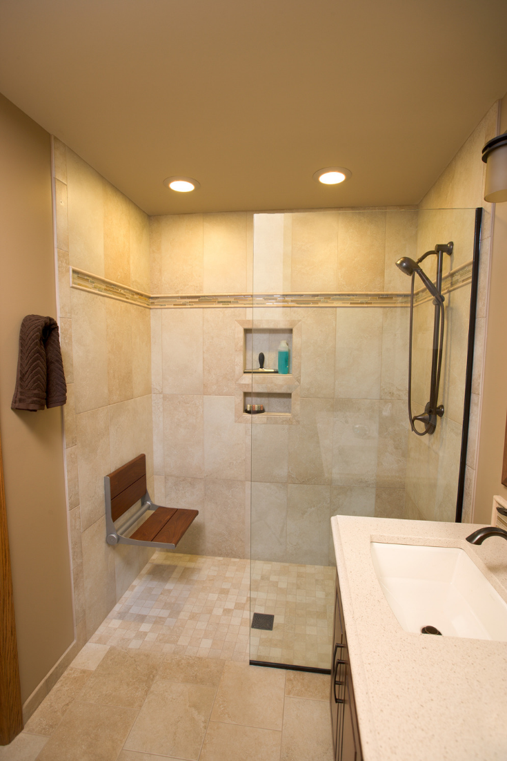 Large wall tiles in a one level wet room | Innovate Building Solutions | #LargeTiles #TiledShower #BathroomRemodelDIY