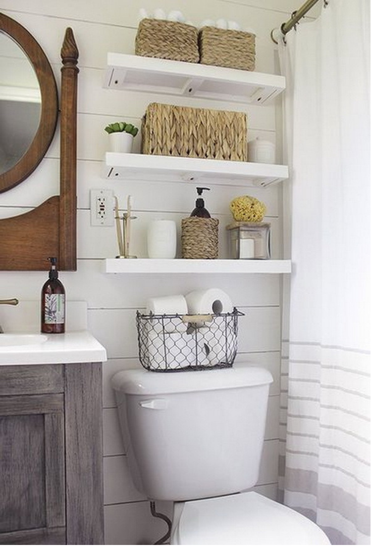 Floating shelves over a toilet | Innovate Building Solutions | #FloatingShelves #StorageSolutions #StorageOptions