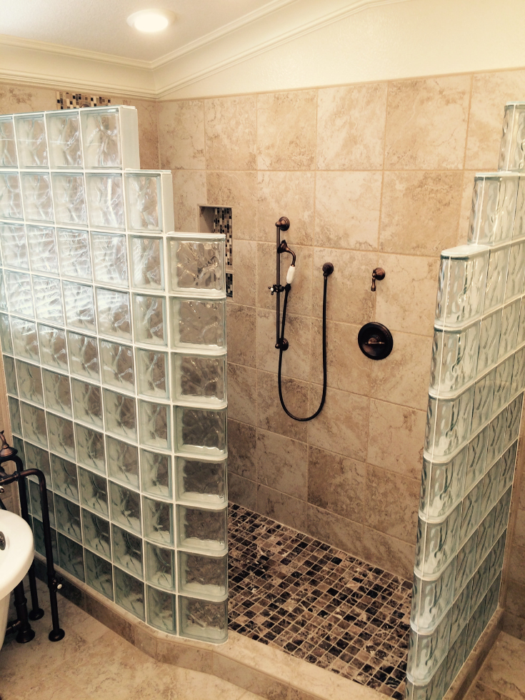 Curved glass block shower wall with a ready for tile shower pan | Innovate Building Solutions | #GlassBlockShower #CurvedGlassBlock #GlassBlockShowerDesign #ShowerBase #TiledBase