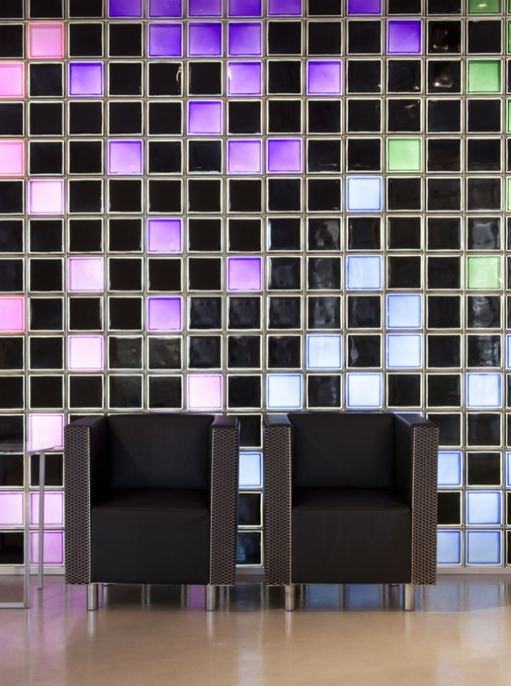Minimalist colored glass blocks in a building lobby | Innovate Building Solutions | #coloredglassblock #glassblockdesign #showerglassblock