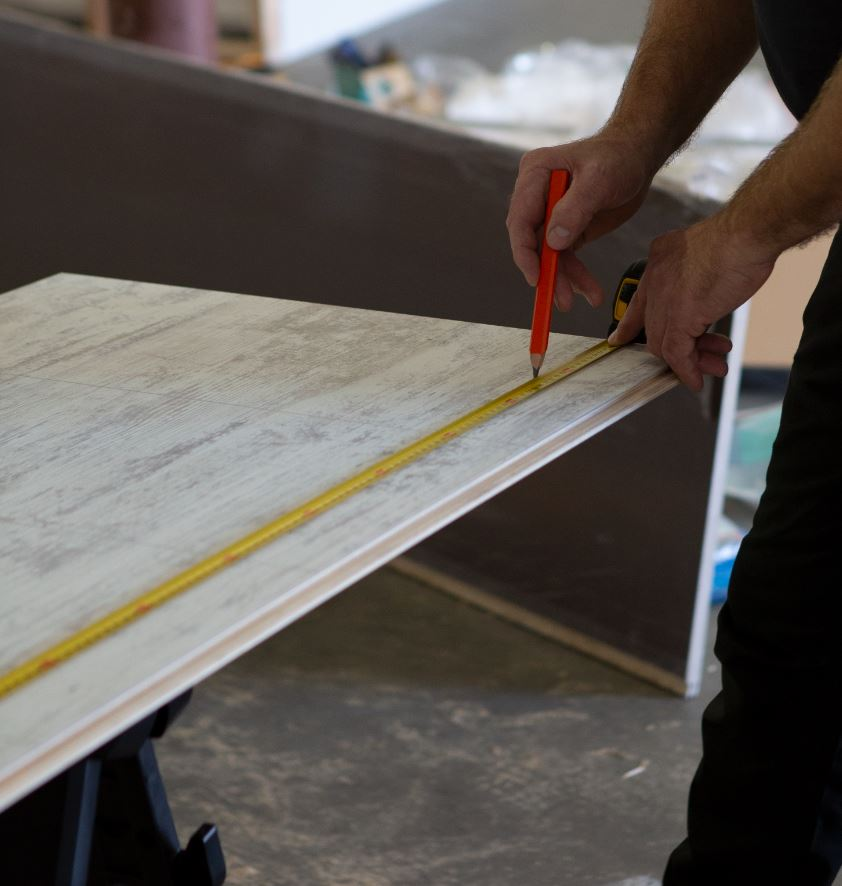 2 foot by 8 foot laminated wall panels being marked for cutting | Innovate Building Solutions | #LaminatePanels #CuttingPanels #HowToCutPanels #ShowerWallPanels