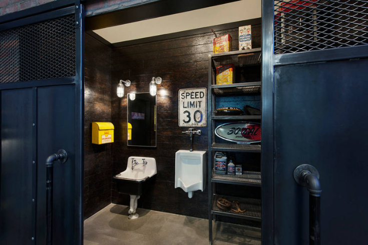 Fun quirky signs in an industrial chic bathroom design | Innovate Building Solutions | #IndustrialBathroom #Funkybathroom #BathroomDesign